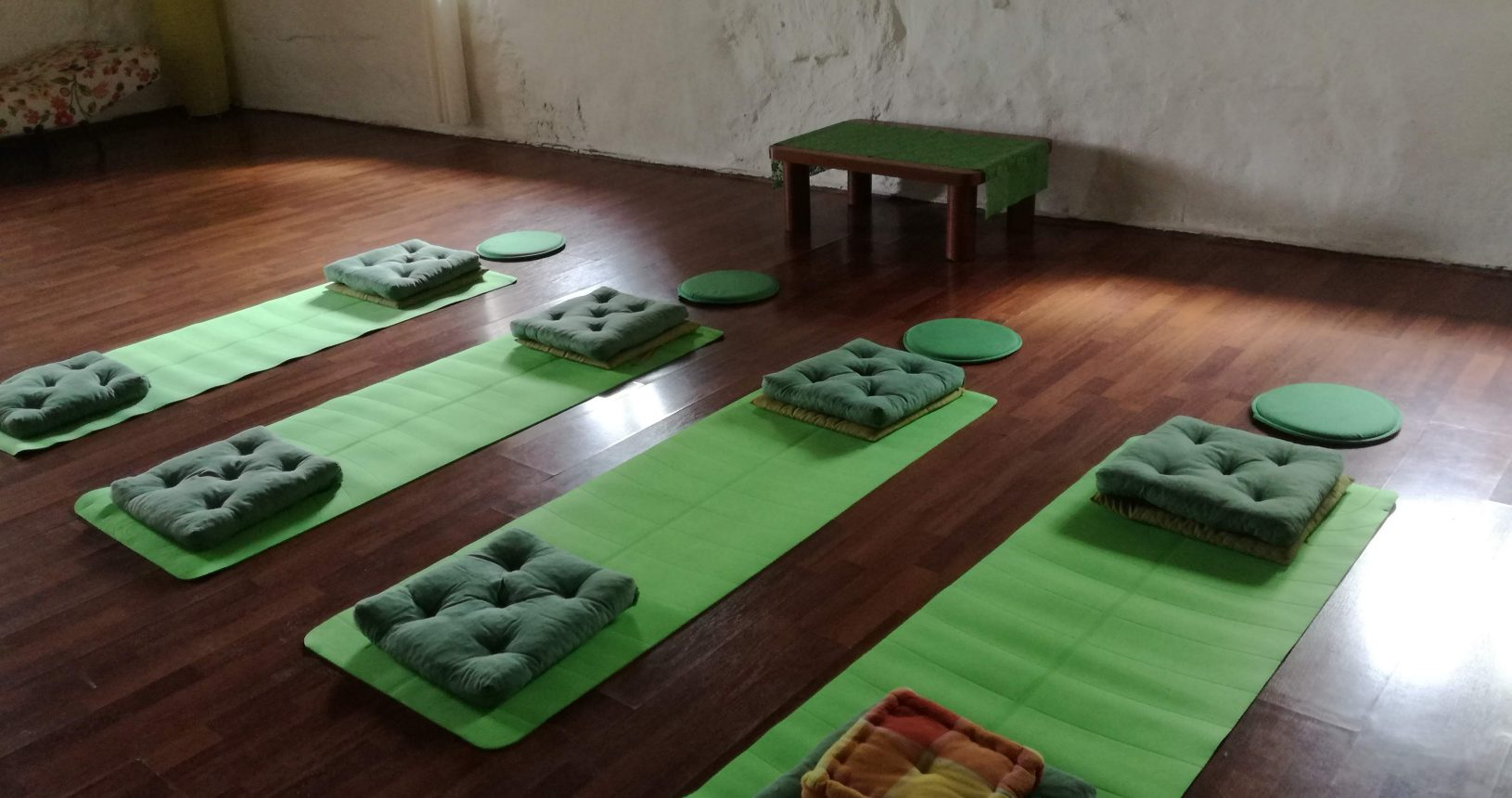 seminar room with green yoga mats